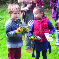 Sowing wildflower seeds at Children's meeting